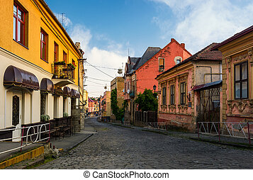 empty street of old town on summer morning. cobblestone...