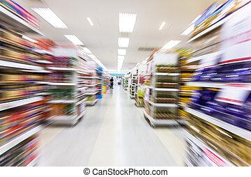 Empty supermarket aisle, motion blur