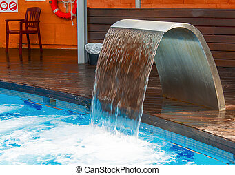 Empty Swimming pool with waterfall jet