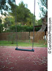 Empty swing in the backyard.