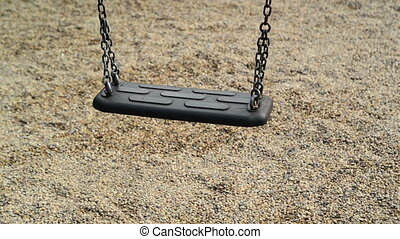 Empty swing seat swaying at playground in the park. 1920x1080, full hd footage.