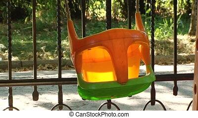 Empty swings for children riding in itself.