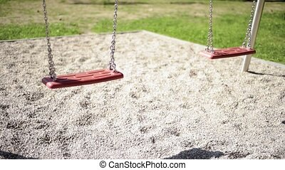 Empty swings at playground