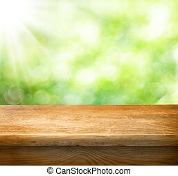 empty table - Empty table and defocused fresh green...