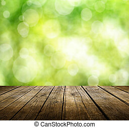 Empty table - Empty wooden deck table with green spring...