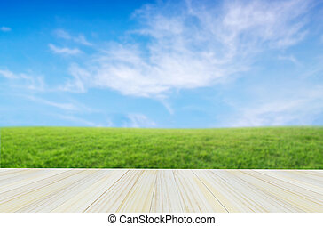 Empty table top for your product display montage on nature background.
