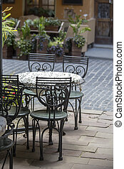 Empty tables and chairs on outdoor street cafe in city center of Lviv, Ukraine