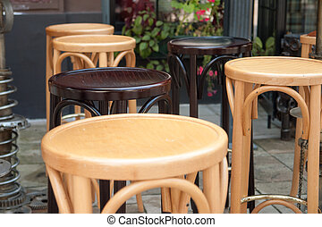 Empty tables and chairs on street cafe
