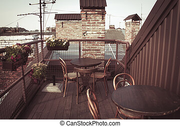 Empty tables of cafe on the roof