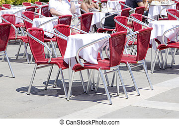 Empty tables of sidewalk cafe