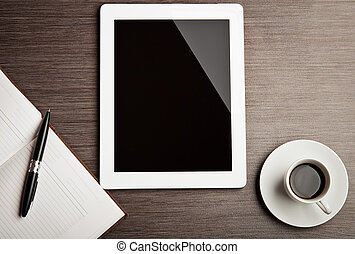 empty tablet and a coffee on the desk - empty tablet and a...