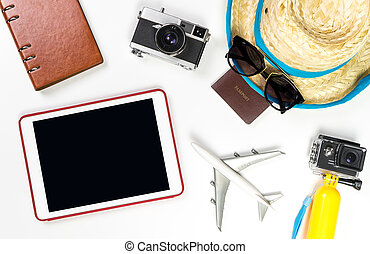 Empty tablet screen with summer travel fashion and objects