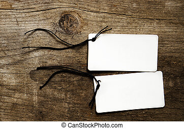 Empty tags on wooden background