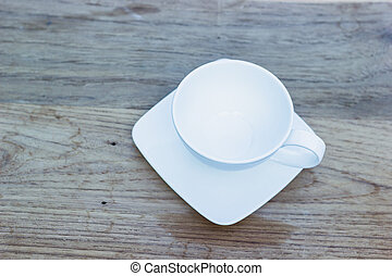 Empty tea cup on wooden table