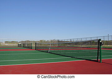 Tennis Courts - Empty Tennis Courts with a Clear Blue Sky