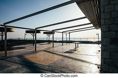 Empty terrace at sunset