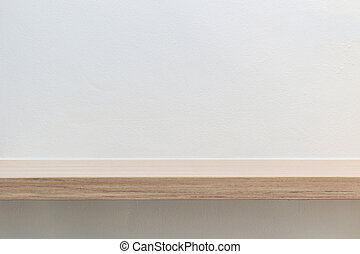 Empty top of wooden shelf on white cement wall background....