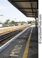 empty train station platform - mind the gap warning - empty...