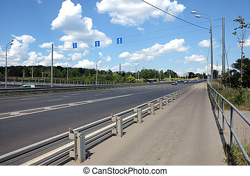 Empty urban highway and pedestrian