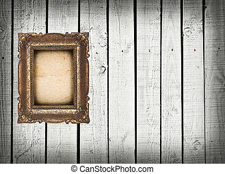 Empty vintage frame on white wooden wall