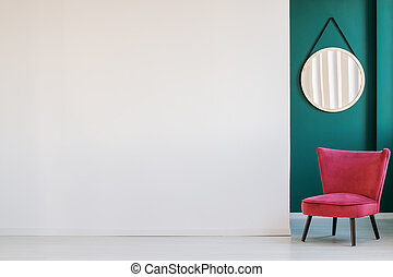 Empty wall and armchair