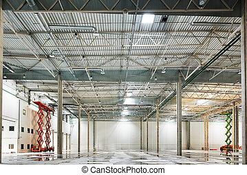 Empty warehouse under construction - modern empty storehouse...