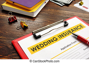 Empty Wedding Insurance form and pen for signing.