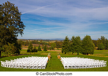 Empty Wedding Venue Seating - White chairs are setup waiting...