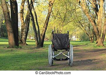 Empty wheelchair in a park