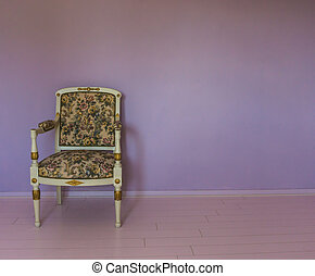 empty white armchair standing in a empty room with pink laminate and purple stone wall background