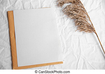 Empty white card with envelope, pampas grass