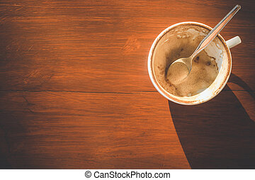 Empty white coffee cup after drink on wooden table with copy...