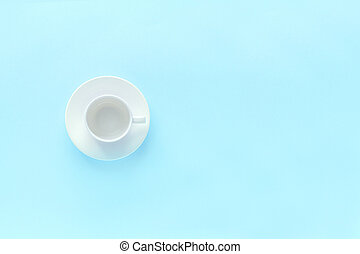empty white coffee cup and dish saucer on blue background - ...