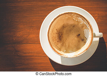 Empty white coffee cup with latte foam after drinking on...