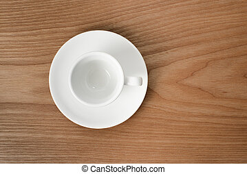 white espresso cup on a wooden plate