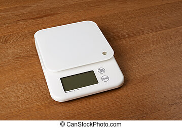 white food scales on a wooden table