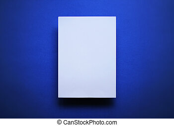 Empty white paper sheet blue background