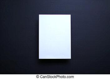 Empty white paper sheet dark blue background
