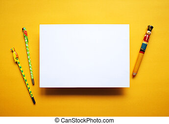 Empty white paper sheet isolated yellow background