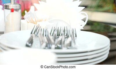 Empty white plate and cutlery on it. fork and knife. slow motion