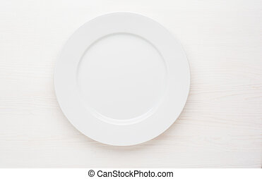 empty white plate on white background top view.