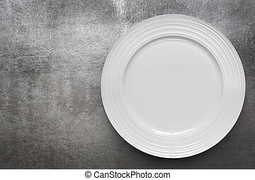 Empty White Plate over Gray Slate Top View