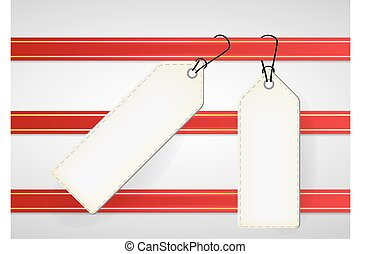 white price tags on red ribbon