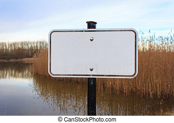Empty white sign / blank sign in nature