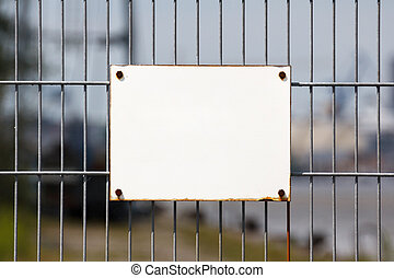 Empty White Sign on Fence