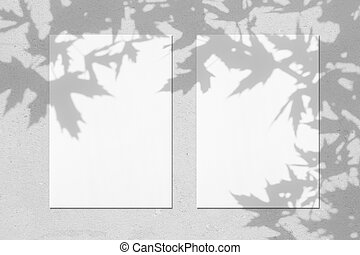 Empty white vertical rectangle poster mockup with maple leaves shadows