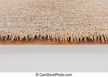 empty white wall with thatched roof