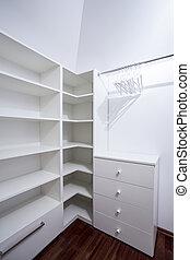 Empty white wardrobe in modern house, vertical
