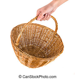 Empty wicker basket for fruits and vegetables in hand isolated on white