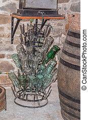 Empty wine bottles in wine cellar